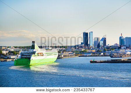 Modern Cruise Motor Ship Is Arriving To Port In Tallinn, Estonia. European Cityscape, Modern Buildin