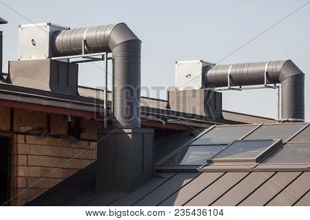 Air Conditioning Equipment Atop A New Metal Roof Of Modern Building