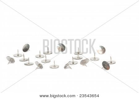 Metal tacks on a white background