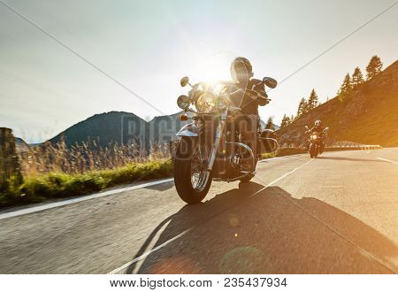Motorcycle drivers riding in Alpine highway on famous Hochalpenstrasse, Austria, central Europe.
