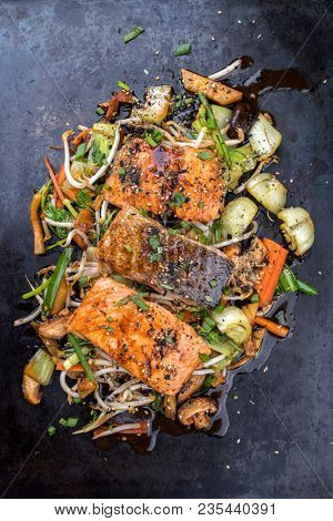 Japanese chan chan yaki with fried, salmon fillet as top view on a board