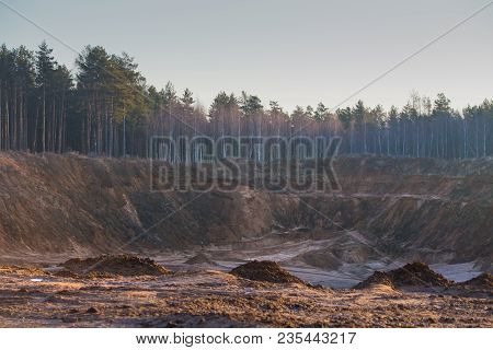 Theme Of Environment Destruction. Development Of Sandy Quarry In Beautiful Forest.