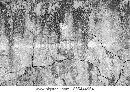 Texture Of Cracked Gray Concrete Wall With Traces Of White Paint. Old Cement Surface. Grunge Backgro