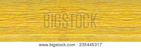 Old Cracked Wooden Plank Painted In Yellow. Sunlit Wood Wide Texture. Sunny Rustic Background