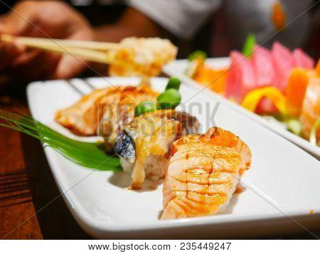 Close Up Sushi Set Sashimi At Japanese Restuarant.sushi Sashimi Is Most Popular With Many Countries.