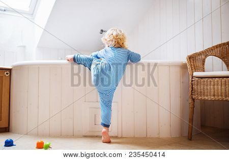 Little Toddler Boy Climbing Into A Bathtub. Domestic Accident. Dangerous Situation In The Bathroom.
