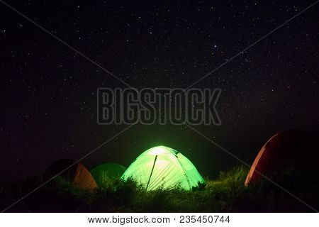 Green Tent For Camping Among Many Star In Night Time