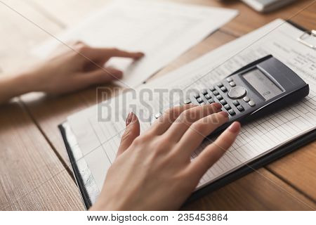 Closeup Of Woman Hands Counting On Calculator And Reading Documents. Financial Background, Count And