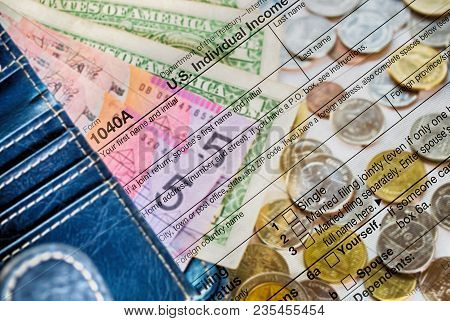 Double Exposure Us Tax Form 1040 With Dollar And Coin. Tax Form Law Document Usa Mathematics Busines
