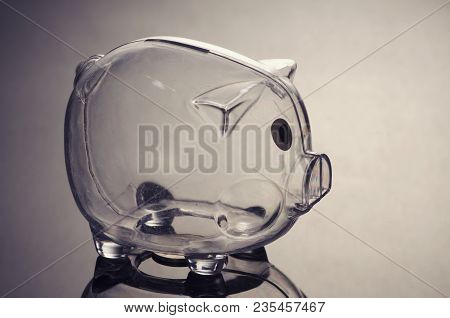 Problem With Saving Money Concept,empty Piggybank On Reflection Table. Shot Under Low Light