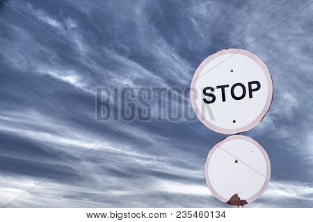 Stop Roadsign On The  Blue Sky Background
