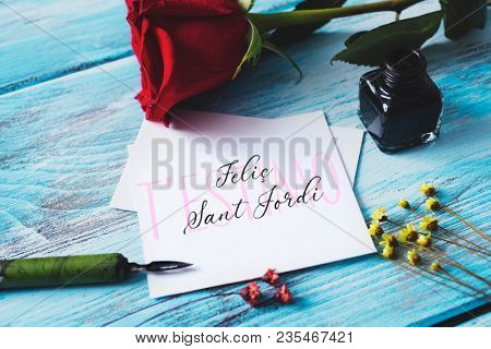 a red rose, an ink bottle, a nib pen and the text t estimo and Felic Sant Jordi, I love you and happy Saint George Day in Catalan, when it is tradition to give roses and books in Catalonia, Spain poster