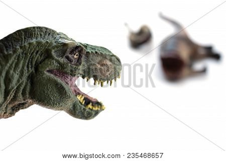 Tyrannosaurus And A Dinosaur Bloody Body On White