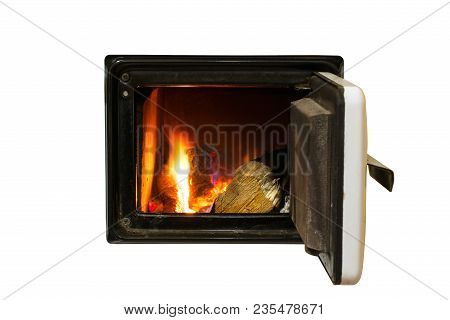 Open Firebox With A Hardwood Log Laid Inside A Furnace. Flames And An Ember Are Visible In A Blurry