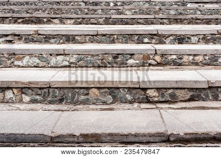 Close-up Old Gray Stony Stairway With Concrete Steps As Background.