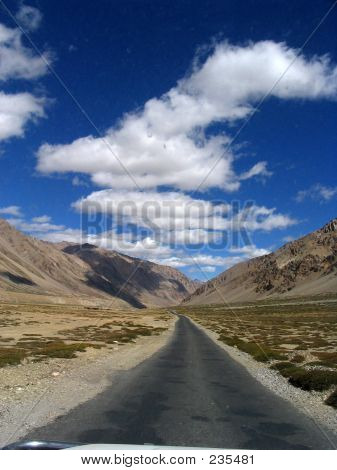 Empty Road In The Middle Of Mountains