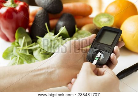 Diabetes Monitor, Diet And Healthy Food Eating Nutritional Concept With Clean Fruits And Vegetables