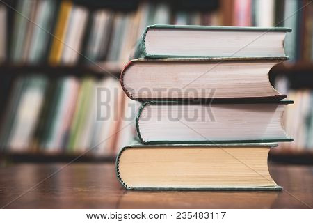 Education Learning Concept, Books On The Desk In The Auditorium, Book Stack On Wood Desk And Blurred