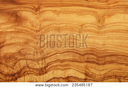 Close Up Yellow And Brown Pattern Of Olive Wood Woodgrain Texture Background
