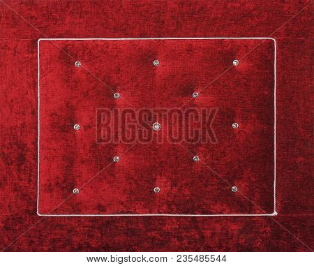 Close up background of dark red burgundy color soft velvet bed headboard with rhinestone crystals, front view poster