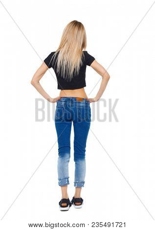Back view of a woman in jeans.  girl  watching. Rear view people collection.  backside view of person. Isolated over white background. Girl in sneakers watching