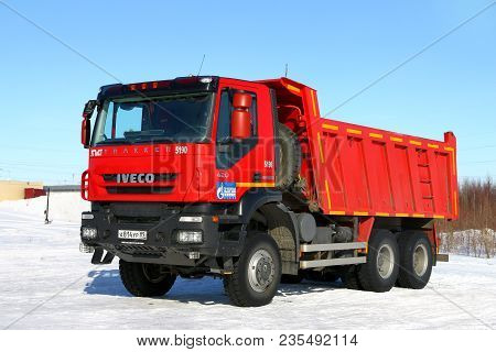Novyy Urengoy, Russia - April 8, 2018: Red Dump Truck Iveco Amt Trakker In The City Street.