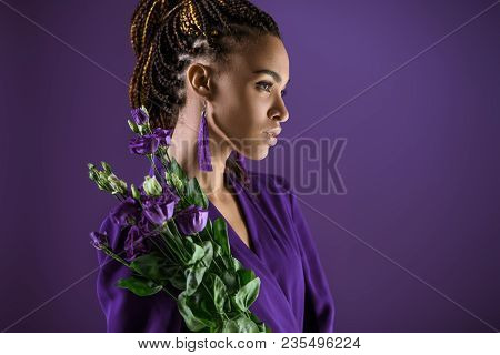 Fashionable African American Girl Posing With Purple Eustoma Flowers, Isolated On Purple, Ultra Viol