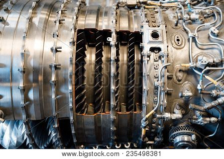 The Pipes And Mechanical Systems Of An Aircraft Jet Engine. Engine Of Fighter Jet, Internal Structur