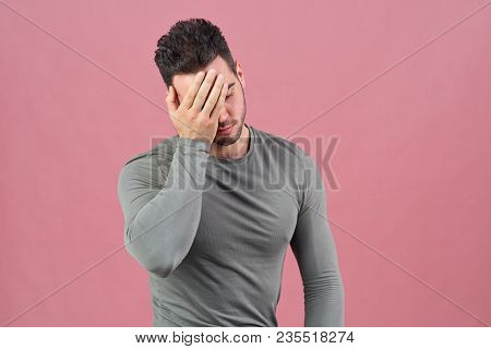 Young Sports Guy Presses His Palm To Face As A Sign Of Shame, Failure, And Headache. Negative Emotio