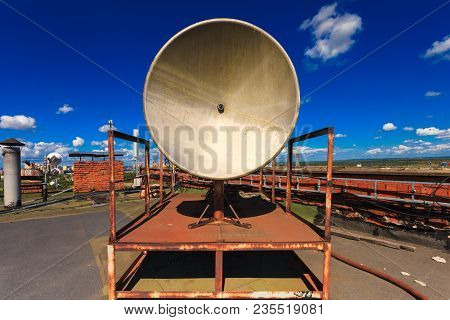 Rusty Small Telecommunication Tower With Old Satellite System Consist Of Old Satellite Dish Antenna