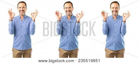 Middle age handsome man doing ok sign gesture with both hands expressing meditation and relaxation over white background