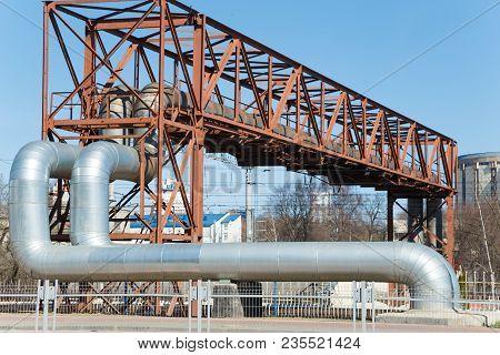 Industrial Huge Pipes On Metal Viaduct Outdoor.