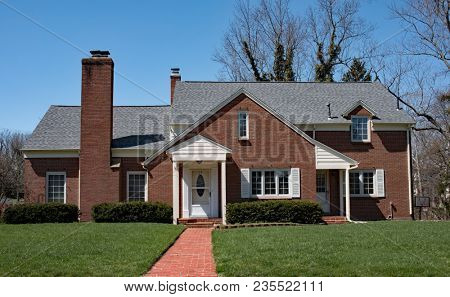 Basic Red Brick Home with Long Brick Walk