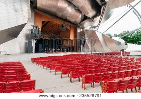 Chicago, Illinois, Usa - August 15, 2014: Red Concert Chairs In The Jay Pritzker Pavilion, Located C