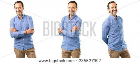 Middle age handsome man with crossed arms confident and happy with a big natural smile laughing over white background