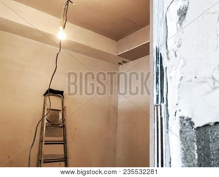A Staircase In The Repair Room. Material For Repairs In An Apartment Is Under Construction Remodelin