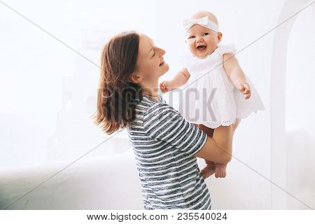 Happy Mother And Cute Baby Girl.