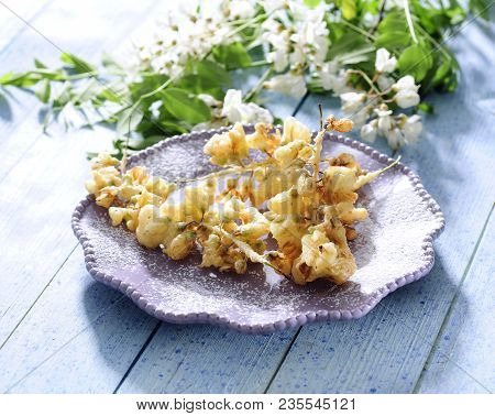 Pan Fried Acacia Flowers Fritters Deeped In Batter