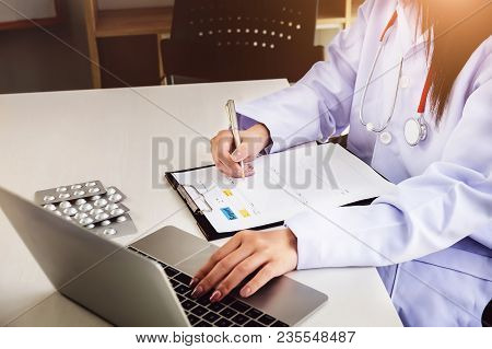 The Doctor  Is Asking The Patient To Keep A Record Of Treatment Using Computer Laptop.