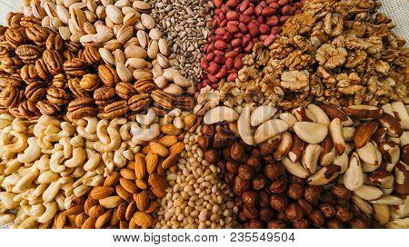 Nuts Mix In A Canvas Bag In Table. Ten Kinds Of Nuts: Pecan, Brazil, Cedar, Sunflower, Hazelnut, Alm