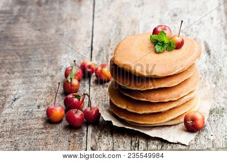 Stack  Of Scotch Pancakes With Fresh Wild Apples On Wooden Table