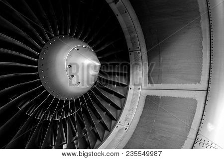 Blades Of An Aircraft Engine Close-up. Travel And Aerospace Concept. Black And White Filter.