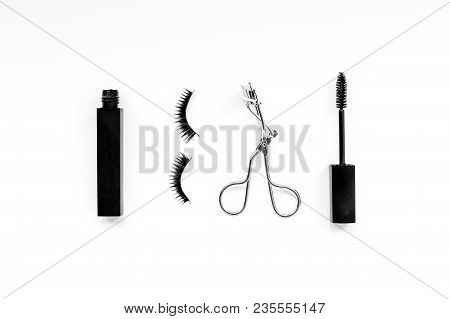 Cosmetics And Tools For Voluminous Lashes. Mascara, False Eyelashes, Eyelash Curler On White Backgro