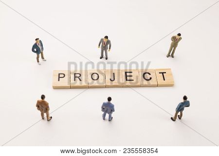 Miniature Figures Businessman : Meeting On Project Word By Wooden Block Word On White Paper Backgrou