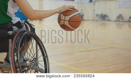 Wheelchair Basketball Player Dribbling The Ball Quickly During Training Of Disabled Sportsmen, Close