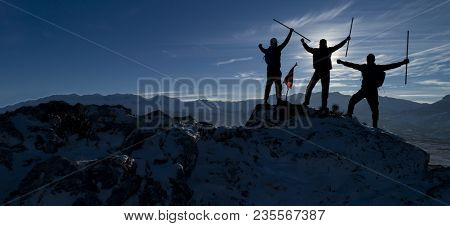 Successful Mountaineers Silhouette ;mountaineers Group And Success Concept