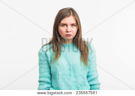 Portrait Of Angry Woman Standing On White Background.