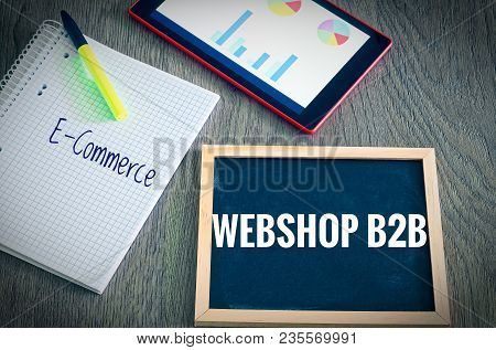 Plate With The Inscription Webshop B2b (business To Business) And E-commerce  With A Tablet Graphs A
