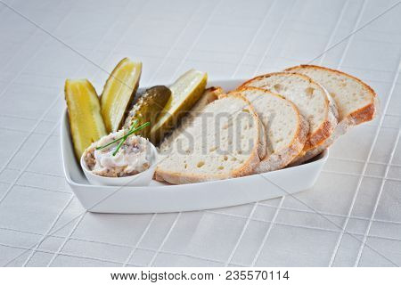 Hearty lard with fresh bread and cucumbers - food and drink
