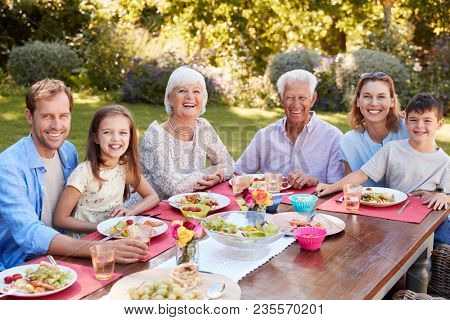 Three generation family having lunch in the garden